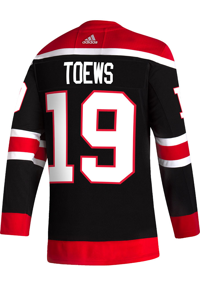 Adidas Jonathan Toews Chicago Blackhawks Mens Black Reverse Retro Hockey Jersey - Image 1